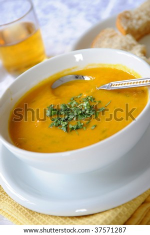 A bowl of carrot and lentil soup