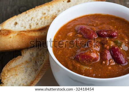 A bowl of chili con carne with toasted baguette - stock photo
