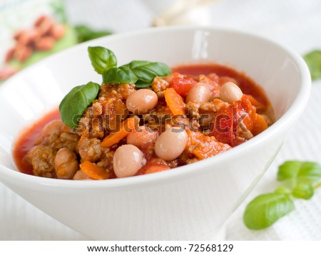 A bowl of chili with bean and minced meat. Soft focus, shallow depth of field. - stock photo