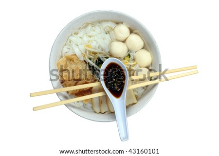 A bowl of Chinese flat noodles or 'koay teow' with fish balls, fish cakes, bean sprouts and 'fuchuk'