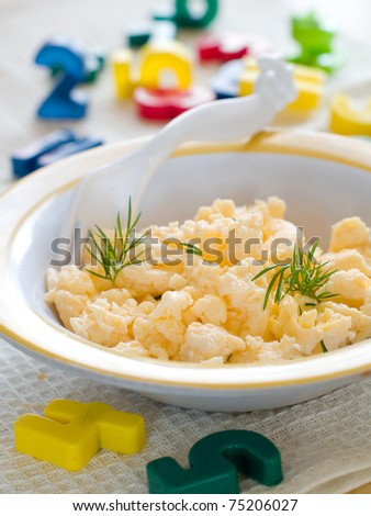 A bowl of creamy scrambled eggs for children