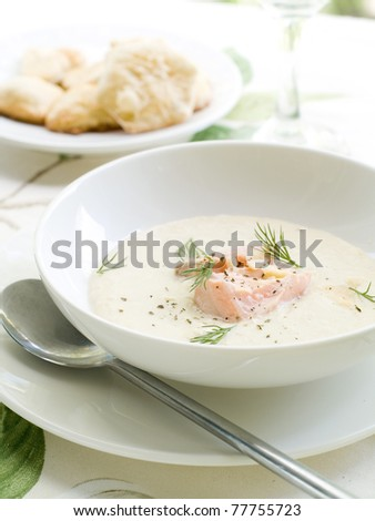 A bowl of creamy soup with salmon. Shallow depth, selective focus