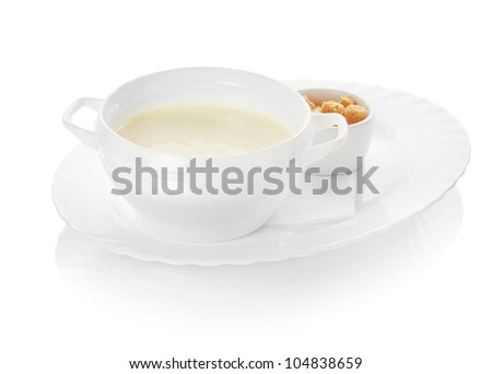 A bowl of creamy vegetable soup isolated