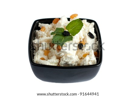 A bowl of delicious and fresh cheese. Isolated on white