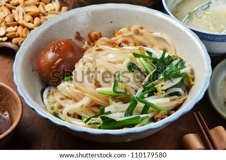 A bowl of dry noodles  on wood table
