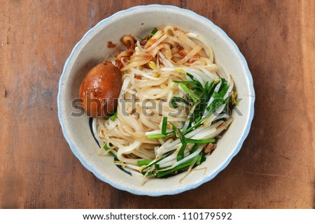 A bowl of dry noodles  on wood table - stock photo