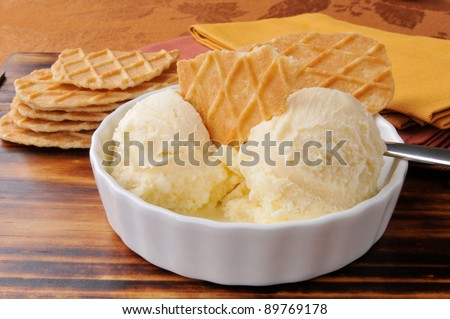 A bowl of French vanilla ice cream with gourmet caramel butter toffee wafers