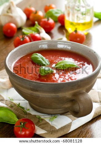 A bowl of  fresh gazpacho (cold tomato soup).