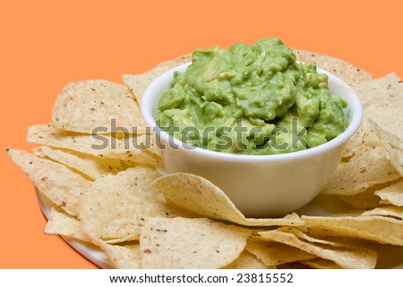 Bowl Of Fresh Guacamole, Surrounded By Crispy Corn Tortilla Chips ...
