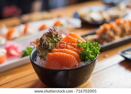 a bowl of fresh salmon #716702005