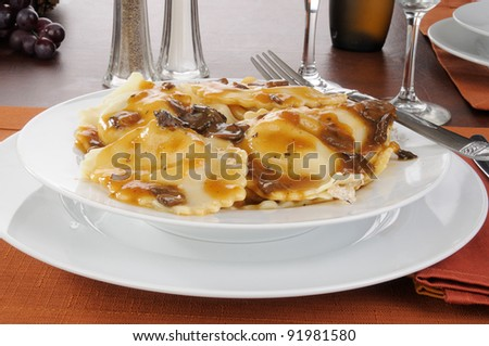 A bowl of gourmet chicken and mushroom ravioli with Marsala wine sauce