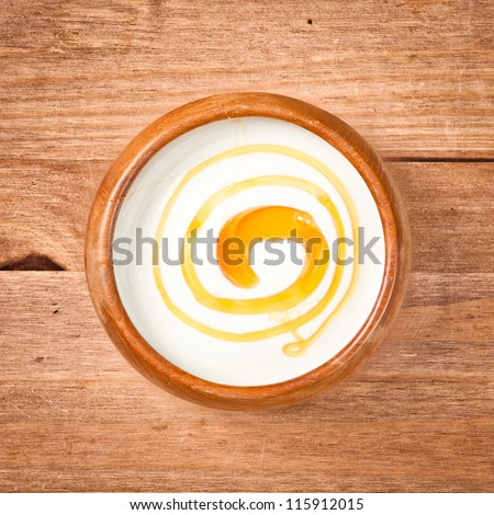 A bowl of greek yogurt with honey