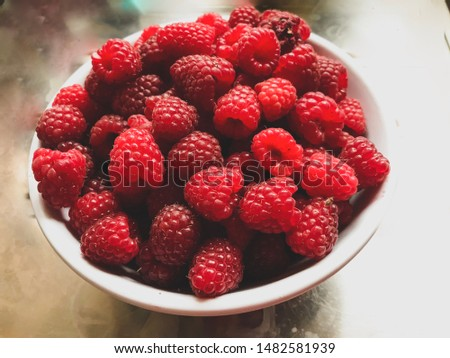 A bowl of homegrown raspberries.