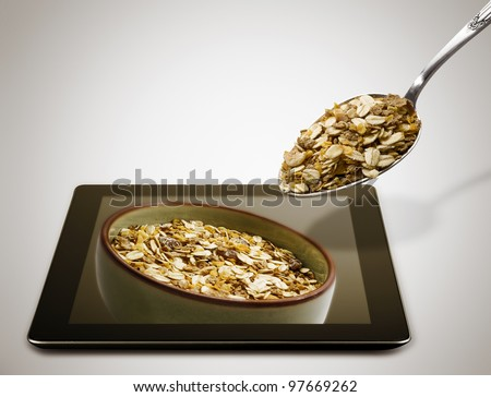 a bowl of muesli on a tablet pc
