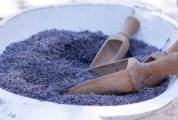 A bowl of natural dried fragrant purple lavender flower after harvest, mediterranean and floral scent, relaxing and calming, aromatherapy concept