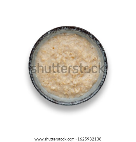 A bowl of nutritious porridge isolated on white with a drop shadow