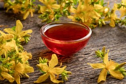 A bowl of red oil made from St. John's wort flowers