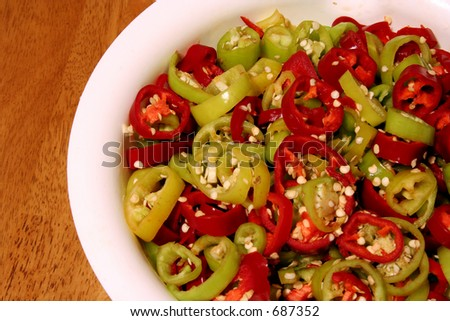 A bowl of spicy red and green hot chili peppers. Seeds included!