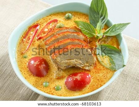 A bowl of Thai duck or chicken curry a great Thai food menu