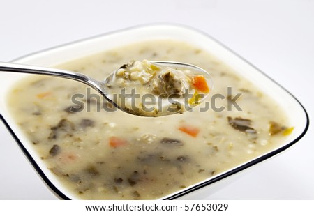 A bowl of traditional Italian Meatball and vegetable wedding soup