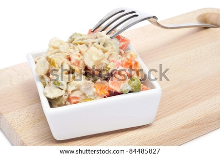 a bowl with ensaladilla rusa, russian salad, typical tapas in Spain