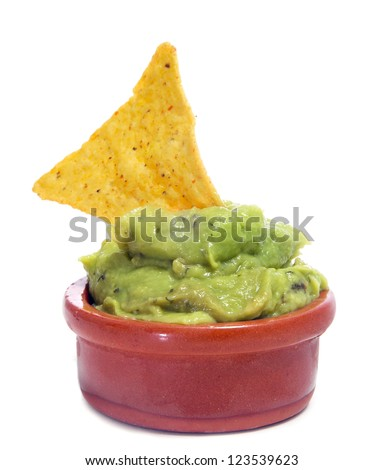 a bowl with guacamole and a nacho on a white background