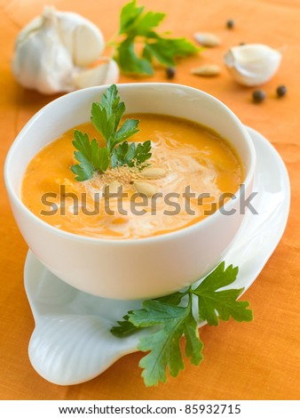 A bowl with pumpkin cream soup with crouton. Selective focus