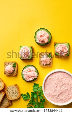 A bowl with tarama and crostini or taramasalata canape on the yellow background, top view with copy space Stok fotoğraf ©