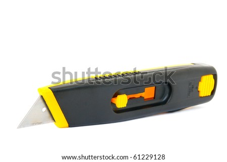 A box cutter isolated against a white background