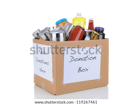 A box full of canned and packaged foodstuff for a charity food donation drive. Isolated on white with reflection. Cans have no labels. Box is at an angle showing two sides both with hand made signs.