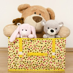 A box full of toys, three bears and a funny rabbit