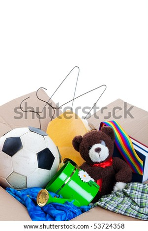 A box of unwanted stuff ready for a garage sale or to donate to a charitable organization.  Generic teddy bear.  Shot on white background.