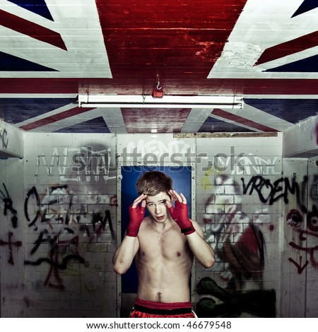 A boxer practising his blocks and rapid movement of evading hits in a graffiti clad suburban basement