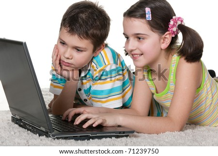 A boy and a girl are studying using a laptop; isolated on the white background