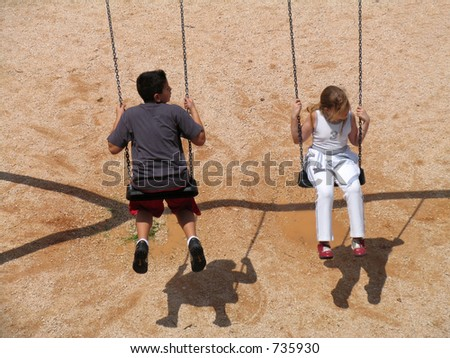 A boy and a girl Swinging,