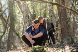 a boy and his father found something in the forest, dug it up or buried it and hid it