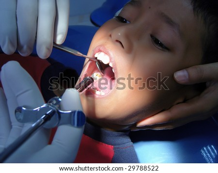 A boy expressions when the needle in his mouth