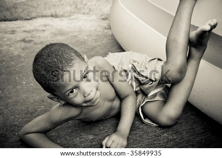 a boy falls out of an inflatable pool