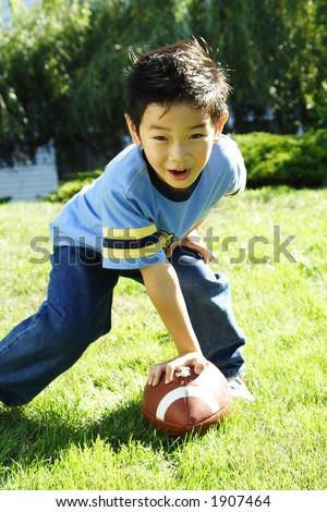 A boy having fun playing football