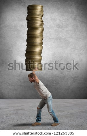 A boy holding a coins stack