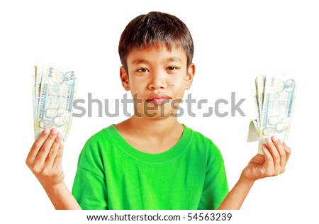 A boy holding Philippines peso bills
