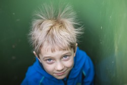 A boy in a chest with spiky hair due to electrify