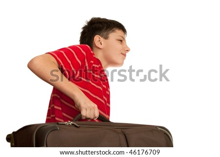 A boy is holding heavy luggage; isolated on the white background