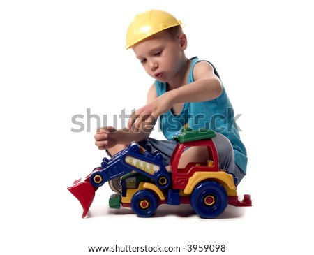 a boy is playing with his dredger - stock photo