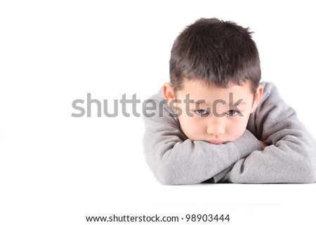 A boy is sad, depressed, thinking something and not looking at the camera