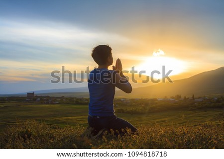 A boy kneeling and praying #1094818718