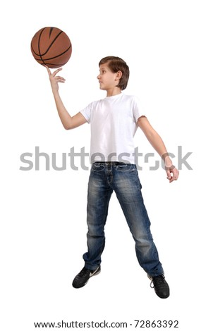 a boy playing with a basketball