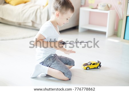 a boy playing with a car remote Stock photo ©