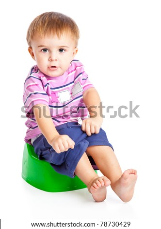 A boy sitting on the pot. Isolated on a white background