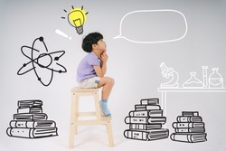 A boy sitting on the small ladder thinking about lots of books and scientific equipment because he want to be the scientist.